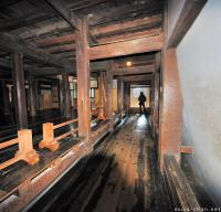 Japanese castle interior, warriors running passage