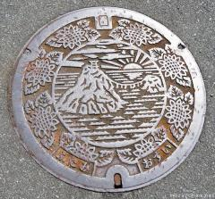 About Japan from... manhole covers, Sunrise at Meoto Iwa