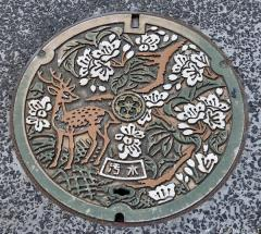 Nara deer and cherry blossoms manhole cover