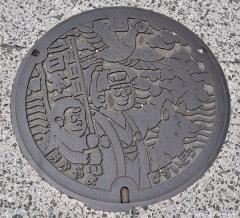 About Japan from... manhole covers, Momotaro
