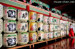 Miko and sake barrels at Toshougu Shrine