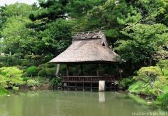 Hiroshima Shukkeien garden pavilion with thatched roof