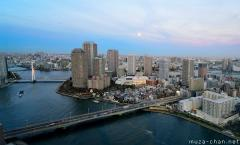 Moon rising over Tsukishima, wide-angle bird's-eye view