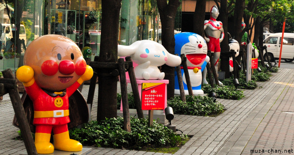 Anime character statues in front of the Bandai building in Asakusa