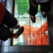 Walking on transparent floor at Tokyo Tower