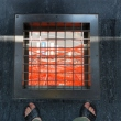 Looking at the transparent floor at Tokyo Tower